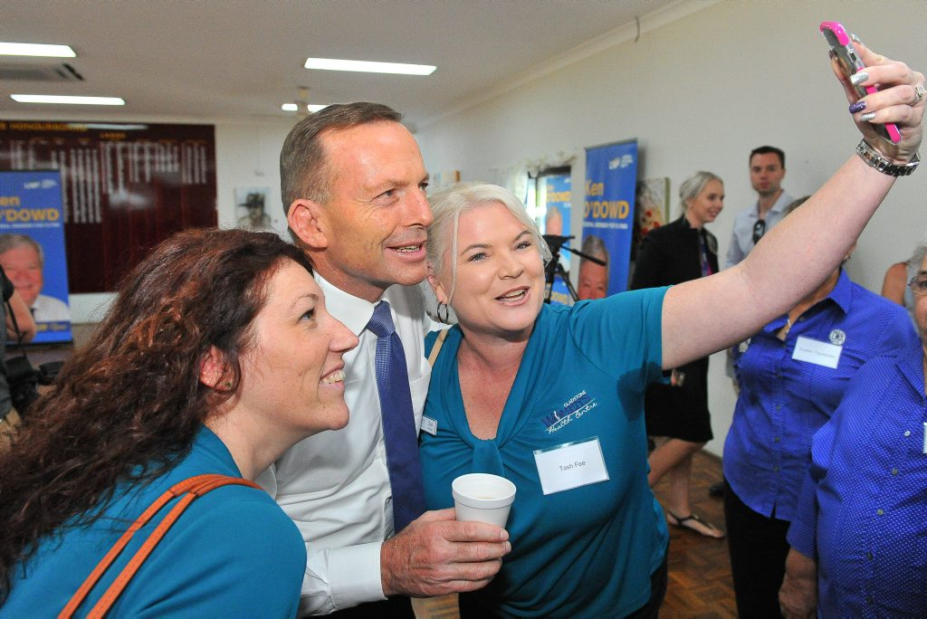 Women's Health Centre manager Natasha Fee and program coordinator Sarah-Jane Olsen had a bet on whether they could get a selfie with the PM.