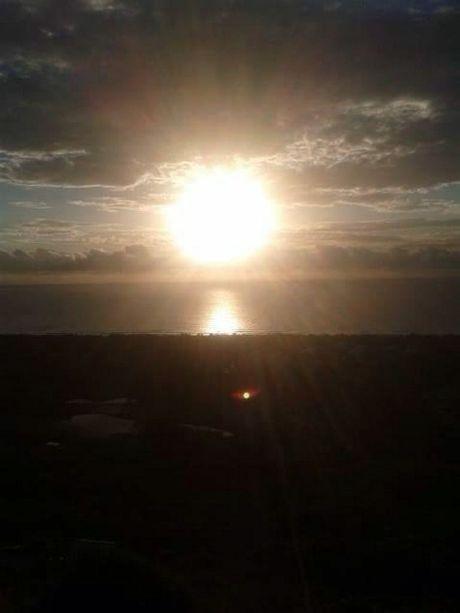 Amanda Jones Up on top of mount Coolum watching the sunrise Photo: Contributed
