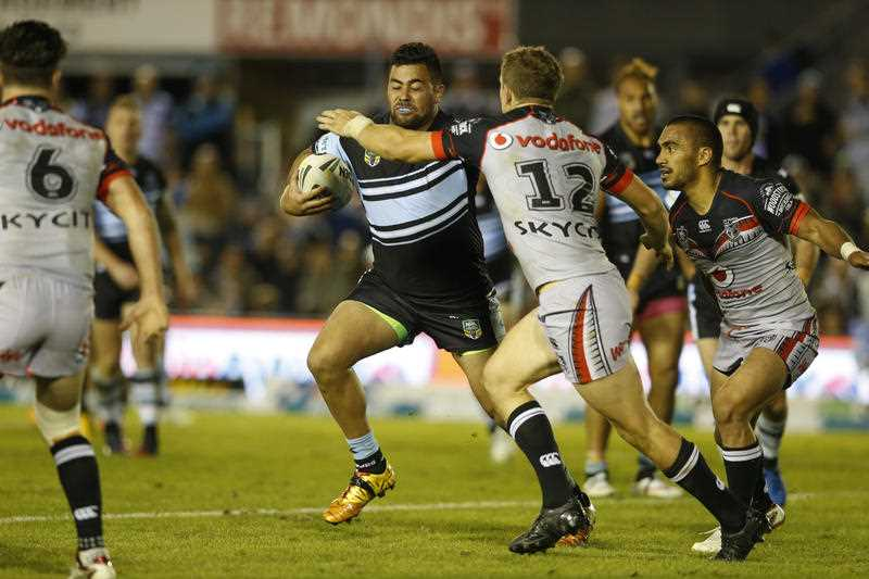 Andrew Fifita of the Cronulla-Sutherland Sharks is tackled by Ryan Hoffman of the New Zealand Warriors during their round 9 NRL match at Redmonis Stadium on Saturday May 9, 2015.