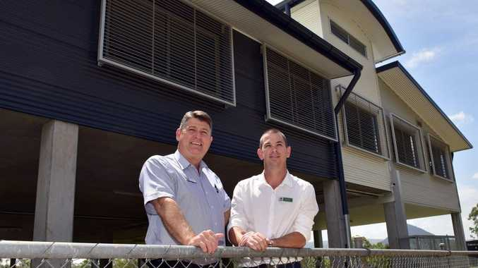 Deputy principal Scott Greinke and head of campus Michael Small admire the new year seven building at the Pomona secondary school campus.