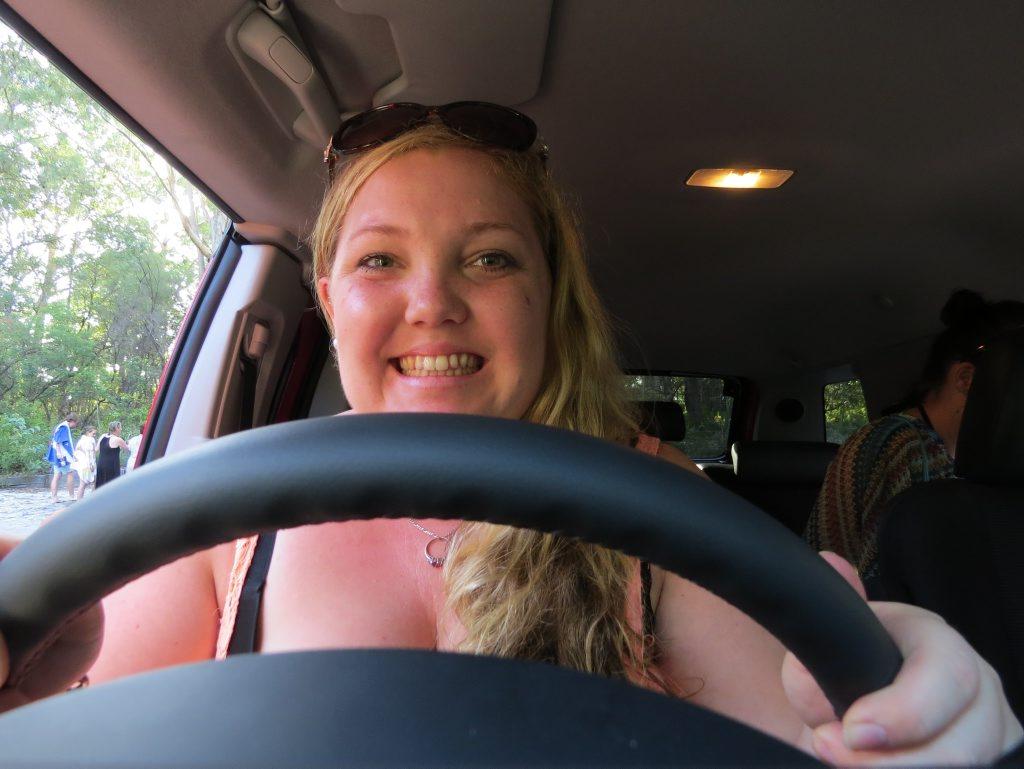 Journalist Kristy Muir behind the wheel on Fraser Island.