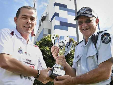 Tony Saunders (left) from Toowoomba Hospital and Sergeant Ian Reimers hold the trophy that will be contested.