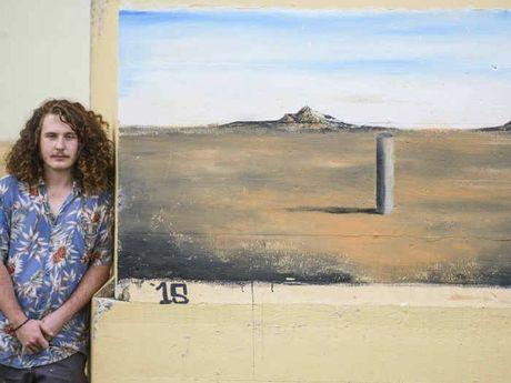 PLEIN AIR: Kade Valja flanks one of his landscape paintings on the Grafton Bridge.