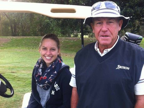 HAPPIER TIMES: Sippy Downs resident Terry Law enjoys a round of golf with German exchange student Alicia Stalf.