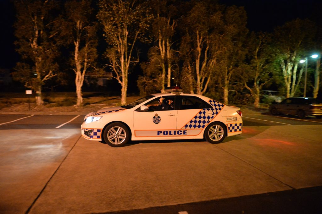 Police on patrol park at the Daily office as their search the Sugar Rd area for an alleged gunman.