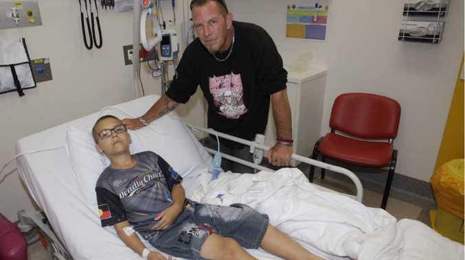 GETTING BETTER: Snakebite victim Zahn Farnham with his dad Renton Eschbank at Caboolture Hospital.