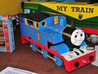 A scale model of Thomas the Tank engine on display.