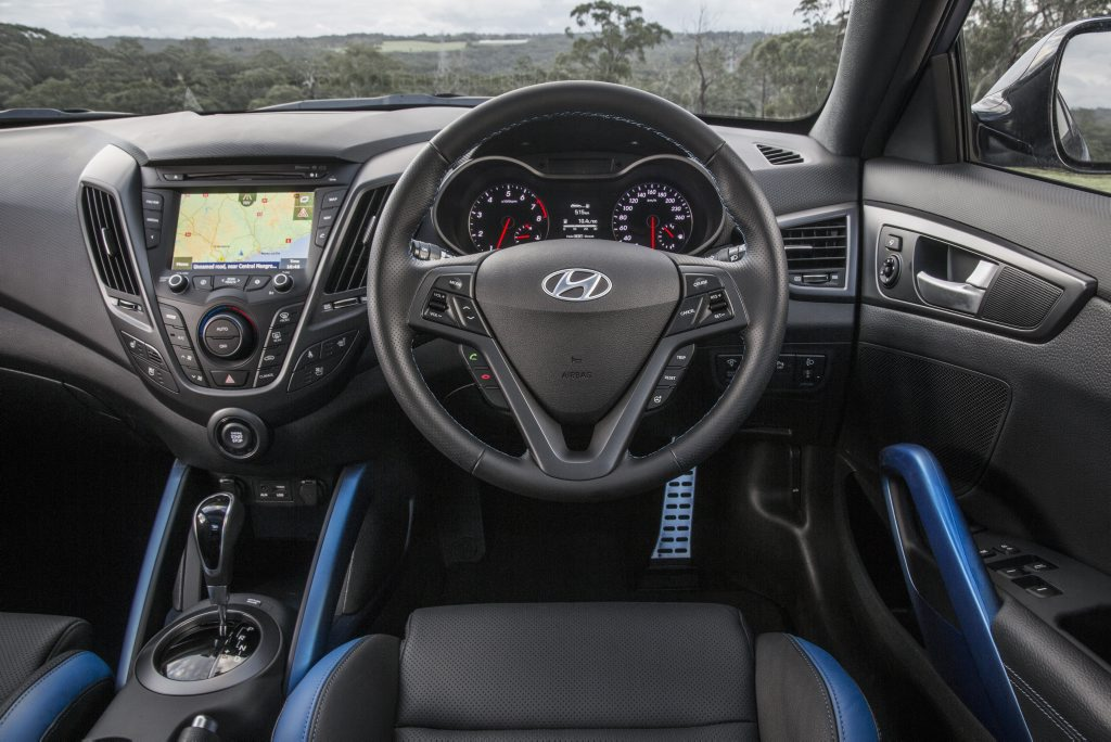 Veloster's cabin receives sporty blue flashes when optioned with matt blue exterior paint