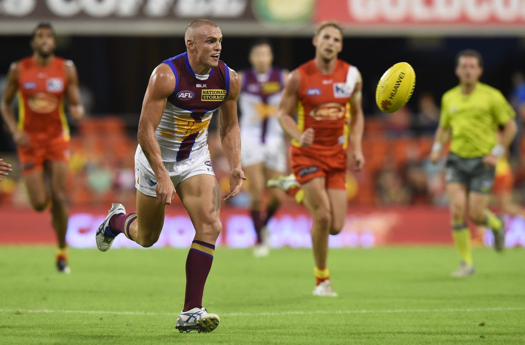 Lions player Mitch Robinson during the round 5 AFL match between the Gold Coast Suns and the Brisbane Lions at Metricon Stadium on the Gold Coast, Saturday, May 2, 2015.(AAP Image/Dave Hunt) NO ARCHIVING, EDITORIAL USE ONLY