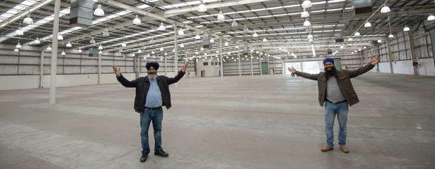 NEW FACILITY: Oz Groups' Kamaldeep Singh Clair and Kulwinder Singh Bajwa at the old Bunnings building.