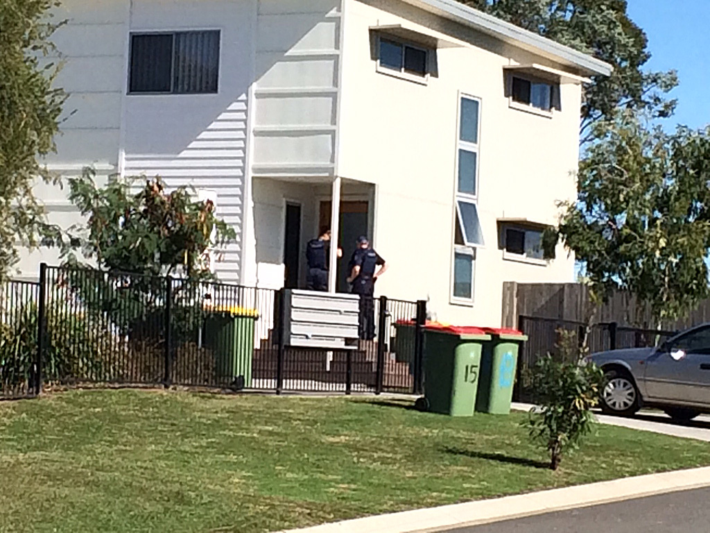 Police have descended on Redbank Plains following reports of a woman robbing a branch of Bank of Queensland while armed with a firearm.