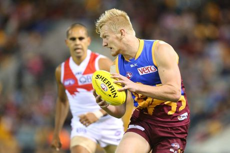 BRISBANE, AUSTRALIA - MAY 03: Nick Robertson of the Lions runs the ball during the round seven AFL match between the Brisbane Lions and the Sydney Swans at The Gabba on May 3, 2014 in Brisbane, Australia. (Photo by Chris Hyde/Getty Images)
