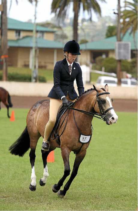 Tara D'hondt of Tamborine keeping her horse Elvonara Park Mary Poppins in control at Lismore Showground on Saturday.