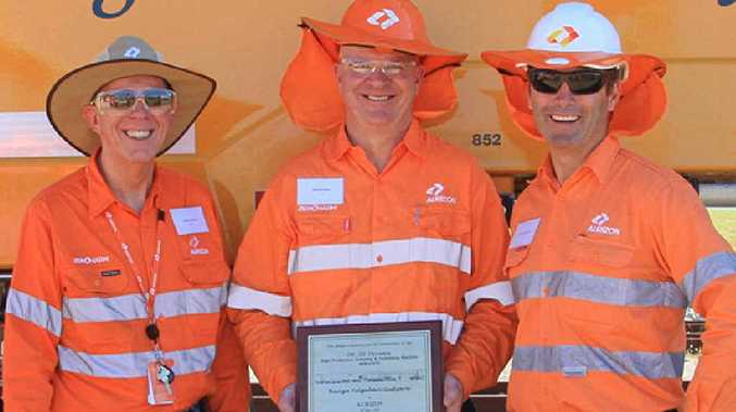 PROUD TEAM: Aurizon's managing director and chief executive officer Lance Hockridge, manager for mechanised production, Mick Keefe, and vice-president for network operations Clay McDonald in front of the new Banga Yulgabari Gudyara.