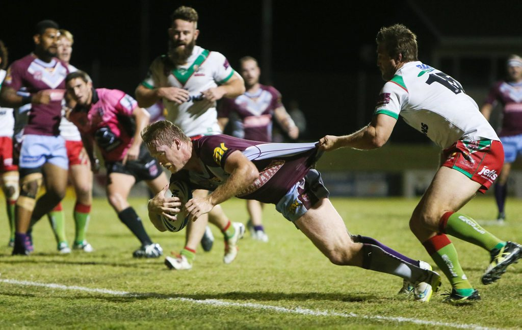 CHARGE ON: Central Queensland Capras captain Guy Williams charges over for a try against Wynnum Manly Seagulls on Saturday night. CONTRIBUTED