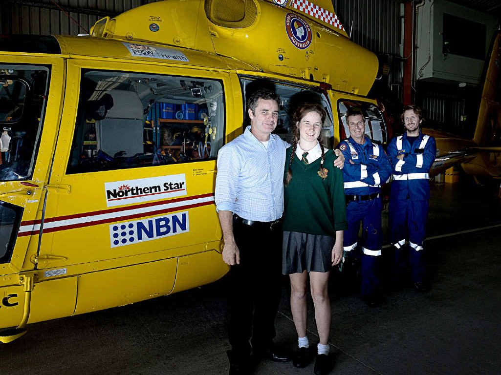 SAFE NOW: Westpac chopper pilot Rob Moore and his daughter Megan of Caniaba are re united after a recent mercy dash to hospital following a fall from a horse.