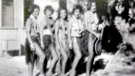 Guests were met by ladies in bikinis and hula skirts upon arrival at Heron Island in the '60s.