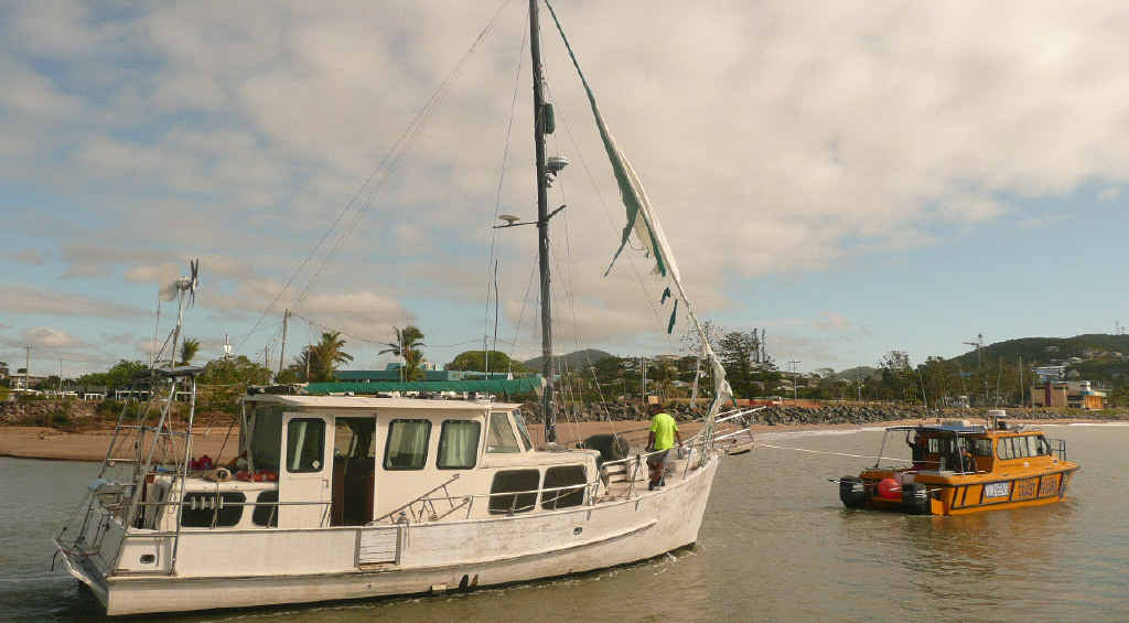 UNDER TOW: Yeppoon Coast Guard tows a boat stranded in Figtree Creek since Cyclone Marcia.
