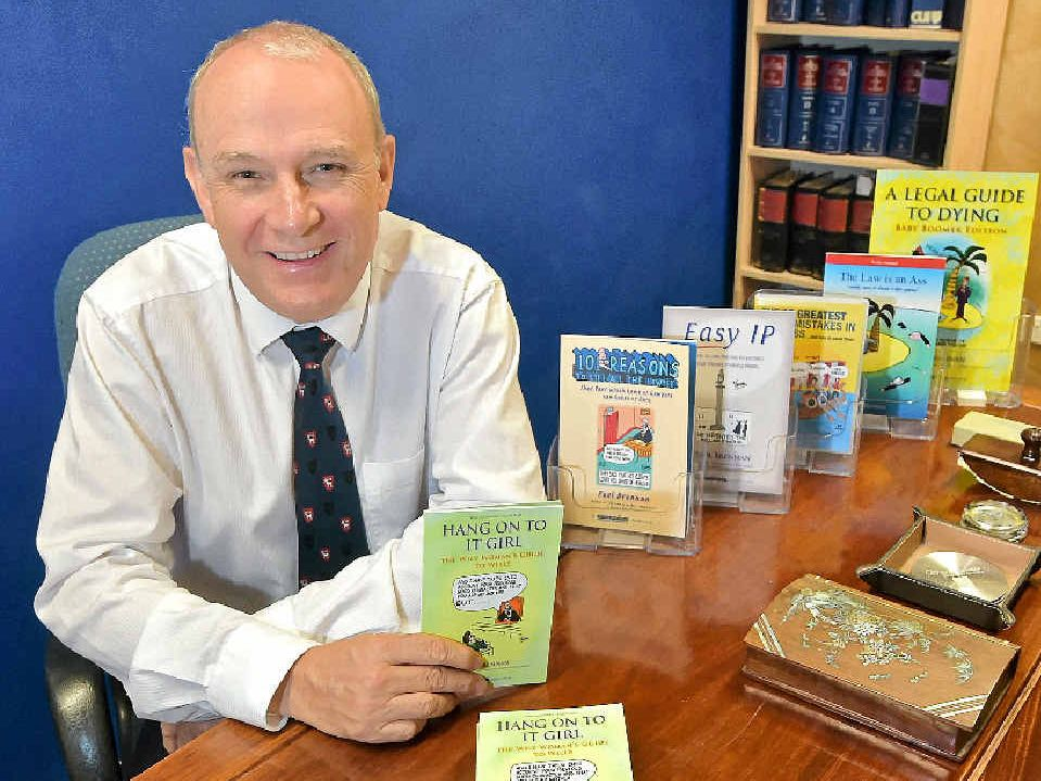LEGALLY FUNNY: Solicitor Paul Brennan with the latest in his series of quick books about the law called Hang On To It Girl – The Wily Woman's Guide to Wills.