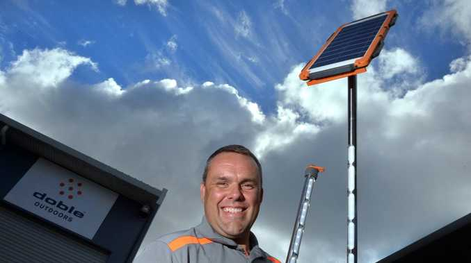 Danny Jaggs of Doble Outdoors with a solar light and phone charger invention. Photo: John McCutcheon / Sunshine Coast Daily