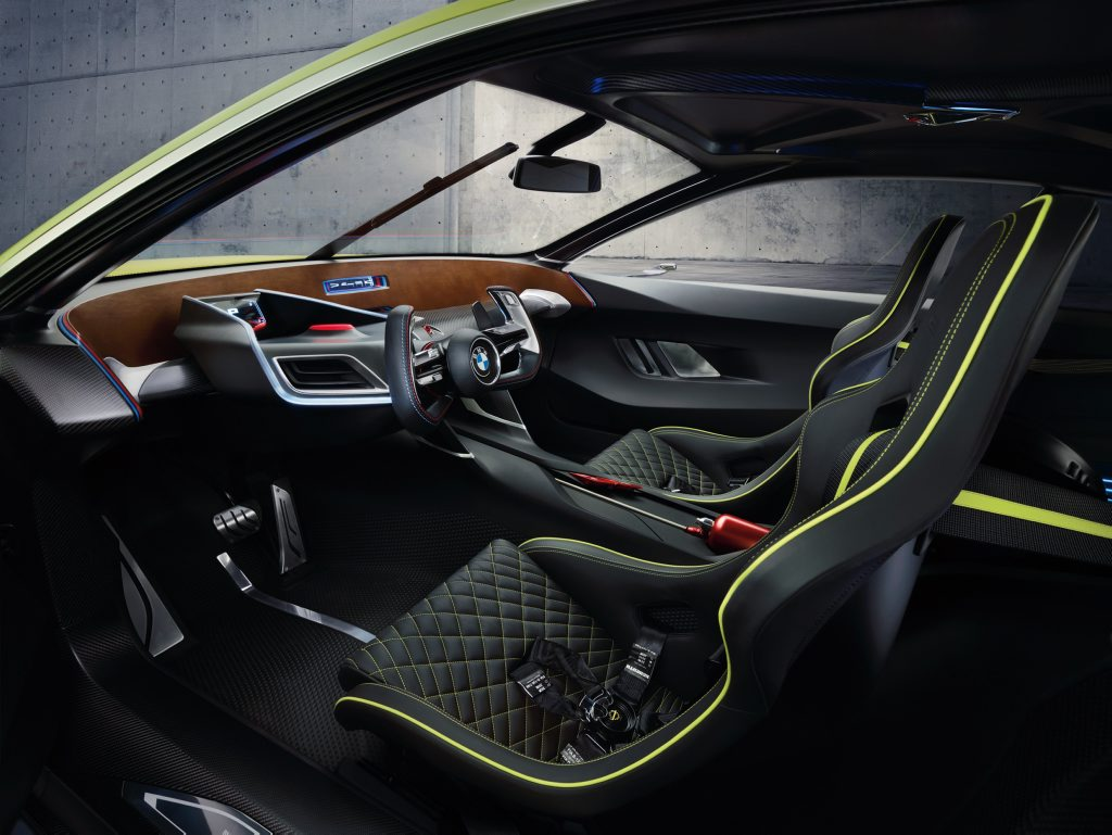 Cabin is almost completely carbon fibre-reinforced plastic with an old CSL-esque wood-effect instrument panel