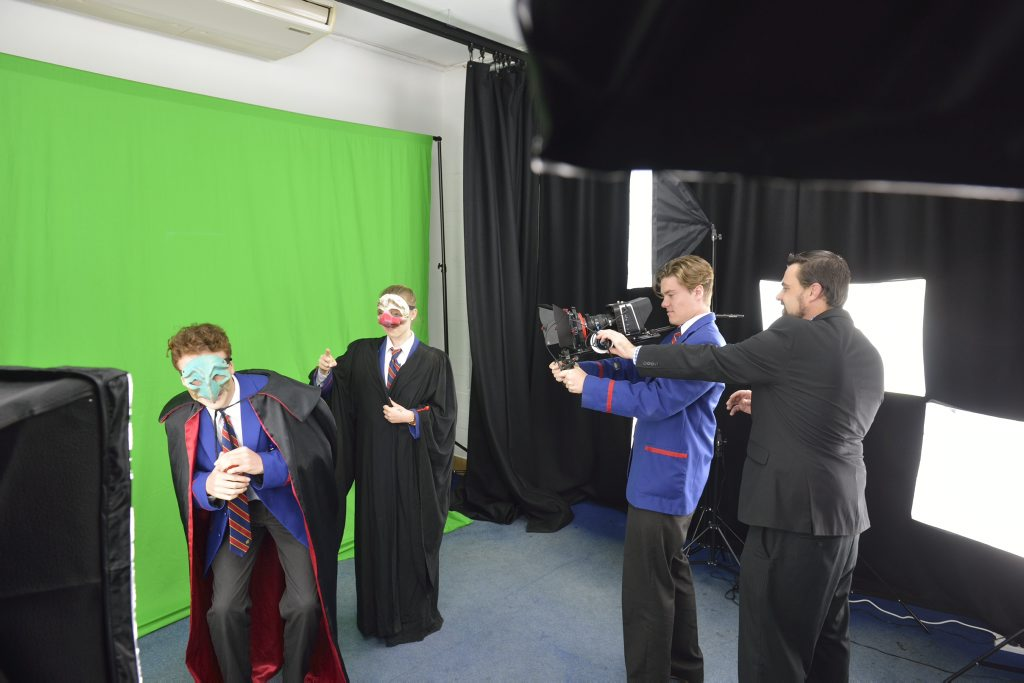 Downlands College students Timothy Humphries-Tattam and Neisha Ryan acting in front of a green screen with Jeremy Beamish on camera under the guidance of teacher Rob Masters.