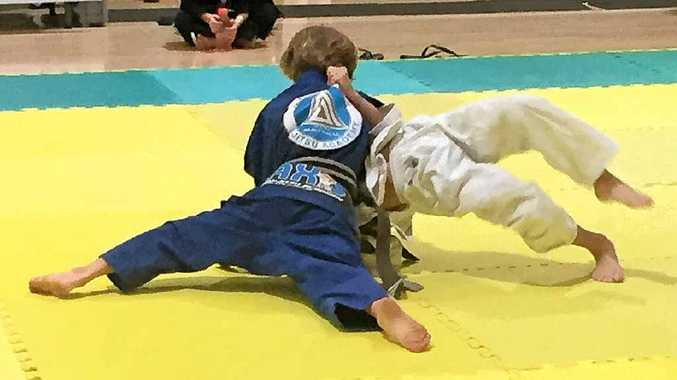 ON TOP: Navrin Redman gets side control of his opponent.