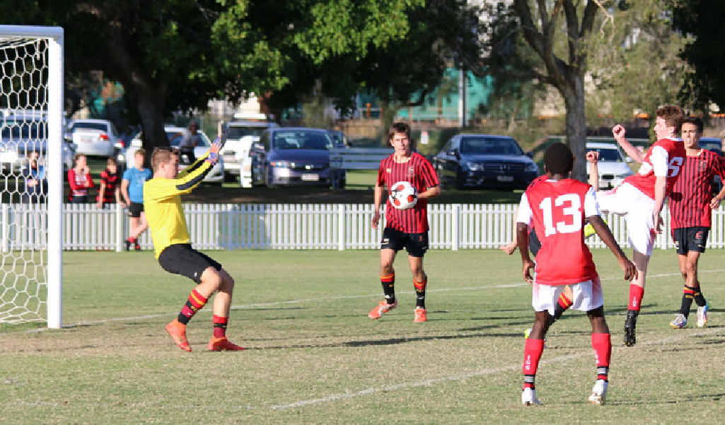 SUPER STRIKE: IGS player Jarrod Norfolk scores his fourth goal in Saturday's comprehensive win over Gregory Terrace.