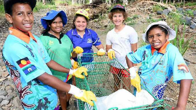 CREEK BUDDIES: Antonio Mann, Haidyn Smith, Teegan Anno, Tom McConville and Chloe Jarrett-Lawton with a shopping trolley recovered from Moores Creek. Now Frenchman's Creek needs help to return to its former glory.