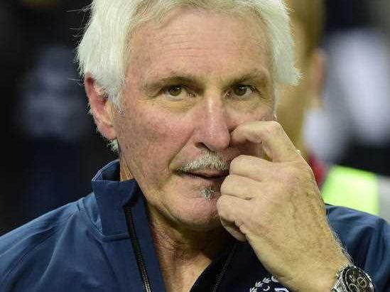 Carlton coach Mick Malthouse makes his way from the ground after the Blues were beaten by the Geelong Cats at Etihad Stadium in Melbourne, Friday, May 22, 2015.
