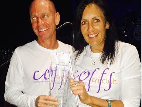 Coffs committee representatives Michael Dougherty and Vicki Tillot accept the coveted trophy.