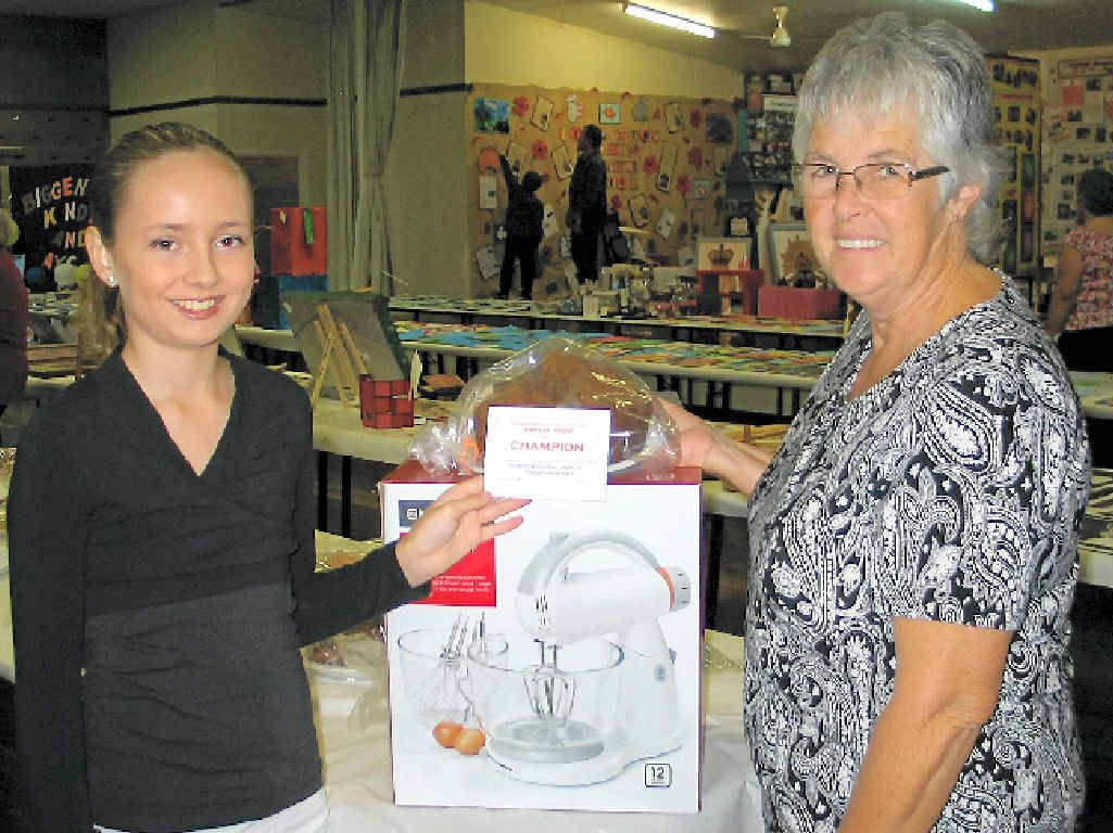 CHAMPION COOK: Monica Hetherington receives a new Mixmaster from Leanne Hebblewhite.