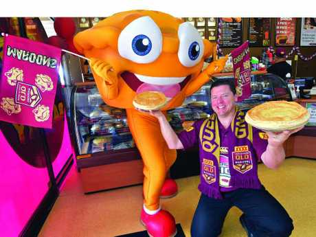 MEATY CHALLENGE: Beefy's owner Mark Hobbs and mascot Mr Beefy get into the spirit of their pie of origin fundraiser.