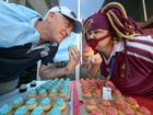 CUPCAKE CHAOS: Fraser Usher and Traci Thornton face off at the State of Origin Cupcake Challenge Fundraiser held at the Bundaberg Hospital to raise money for Give Me Five for Kids.
