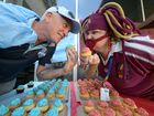 CUPCAKE CHAOS: Fraser Usher and Traci Thornton face off at the State of Origin Cupcake Challenge Fundraiser held at the Bundaberg Hospital to raise money for Give Me Five for Kids. Photo: Max Fleet / NewsMail