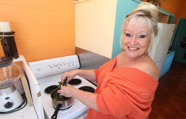 Kinka Beach resident Deb Lindley boils up Paw Paw leaves to drink which she attributes to her cancer remission.   Photo: Chris Ison / The Morning Bulletin