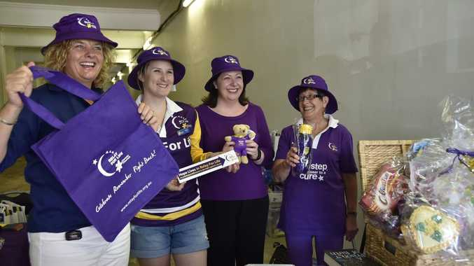 RELAY FOR LIFE: Going purple to raise funds for cancer research are (from left) Jo Capp, Cassie O Dea, Thelma McKeon and Jillian Huth. Promotion for Relay for Life at Heritage Bank. Photo Bev Lacey / The Chronicle