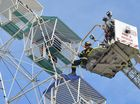 Firemen rescue two people trapped at the top of an Aussie World ferris wheel during an emergency drill.