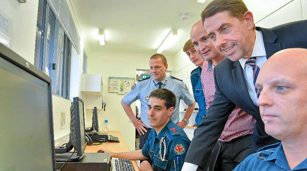 NEW DIGS: Queensland Minister for Health Cameron Dick (second from right) in the communications room at the opening of Gladstone's new ambulance station. He is pictured with Queensland Ambulance commissioner Russell Bowles, Daniel Castagnoli, Samuel Robinson, MP Glenn Butcher, and Spencer Underwood.