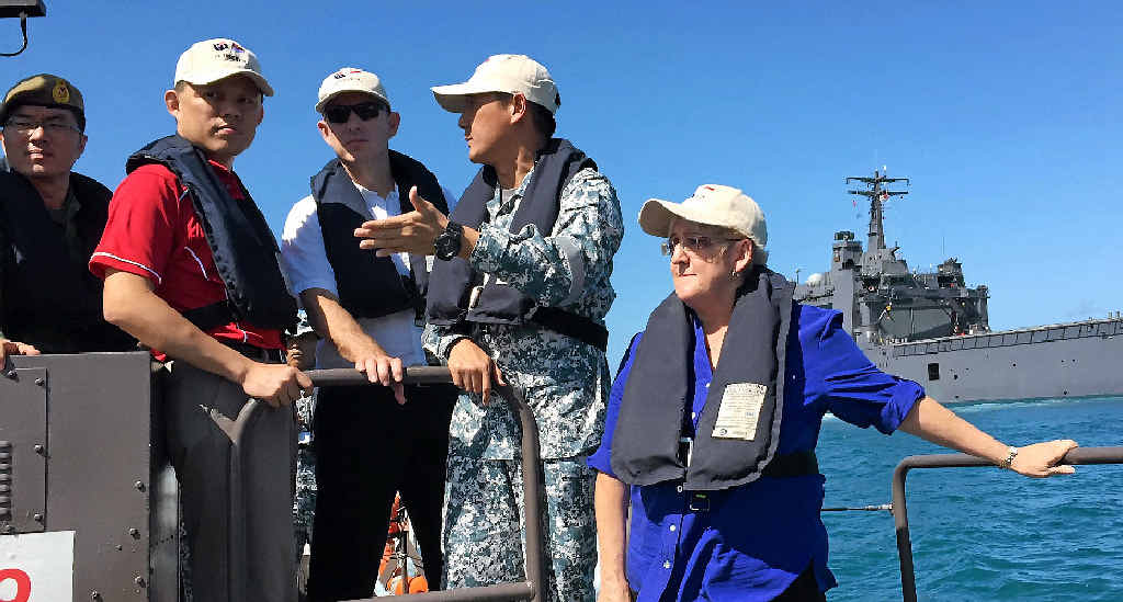 MILITARY MOVE: Minister Chan Chun Sing - Singapore's Second Minister for Defence (red) with Australia's Assistant Minister for Defence Stuart Robert and Michelle Landry MP on board a Singapore military vessel.