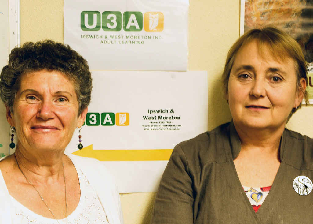NEW LOOK: U3A Ipswich and West Moreton president Diane Dickinson and communications co-ordinator Paulette Montaigne, with the new U3A Logo in the background.