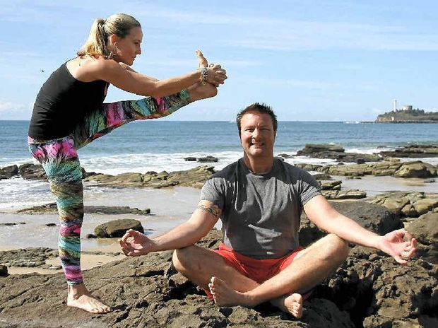Tourism and major events bring millions of dollars into the Sunshine Coast economy each year and the council's 2015-16 budget focuses on continuing that injection. Pictured: Brooke Bastien and Bryan Castle demonstrate some yoga positions on Mooloolaba Beach. Bryan's YogaVida studio is a partner with the Wanderlust Festival which is coming to the Coast in October.