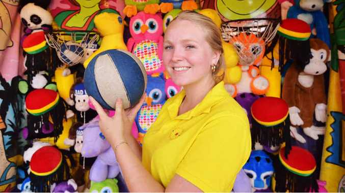 ON TARGET: Bree Roberts shoots some hoops in sideshow alley at the Caloundra Show.