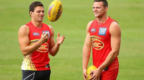 GOLD COAST, AUSTRALIA - JUNE 20: Jesse Lonergan and Steven May talk during a Gold Coast Suns AFL training session at Metricon Stadium on June 20, 2014 in Gold Coast, Australia. (Photo by Chris Hyde/Getty Images)
