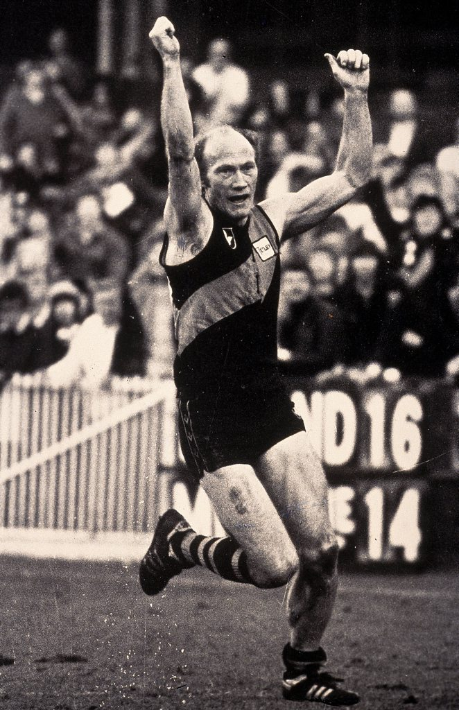 MELBOURNE, AUSTRALIA - 1965: Kevin Bartlett of the Richmond Tigers celebrates after kicking a goal during a VFL match held in Melbourne, Australia. (Photo by Getty Images)