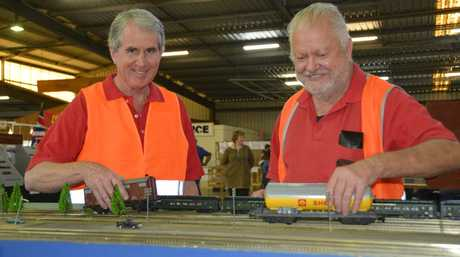Darling Downs Model Railway Club club member Gary Sardoni and secretary Ted Freeman playing with trains at the expo.