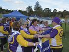 Cancer survivors and supporters complete the first lap of the 2015 Relay for Life.
