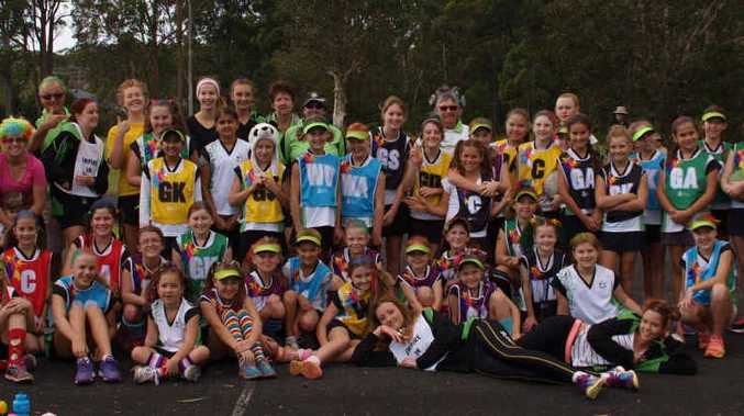 WACKY: Netballers dressed in coloured hair and novelty socks to raise money for The Kids' Cancer Project.