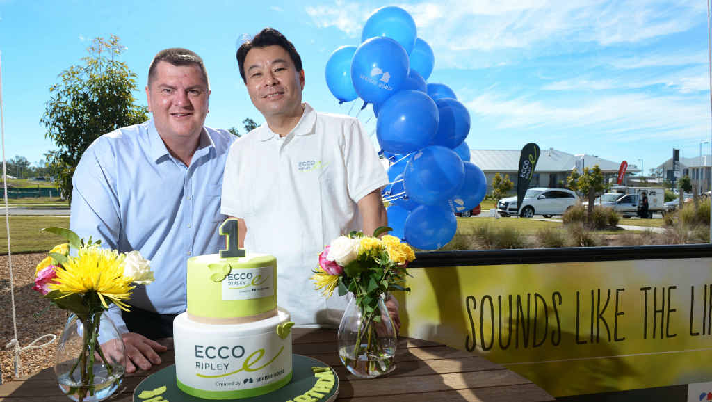 HAPPY DAY: Coles regional manager Wayne Dallinger (left) and Sekisui House Australia managing director Toru Abe celebrate Ecco Ripley's first birthday.