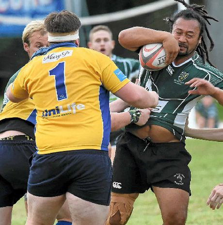STRONG RUN: Lismore City No8 Laau Solomona charges into the Southern Cross University defence during the Far North Coast rugby union game at Maurie Ryan Oval, Lismore, on Saturday.BELOW: The Gold Rats' Tim Breen runs the ball.
